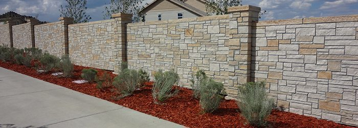 Don't go with wood, a concrete block fence is maintenance free!